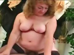 Nasty granny greatly enjoys hard dick inside her hole.