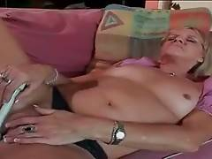Older blonde readily grabs dude`s erect boner as soon as he joins her.