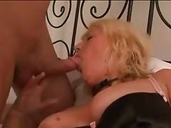 Nasty aged hooker warms herself up waiting for horny guy.