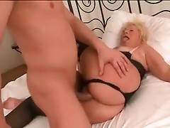 Muscled guy plants his erect boner into granny`s welcome pussy.