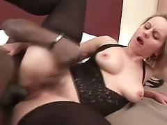 Busty blond granny Magda enjoys huge black cock in her hole.