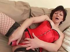 Old brunette in red lingerie is extremely cock hungry.