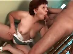 Nasty old tart hungrily swallows younger guy`s boner.